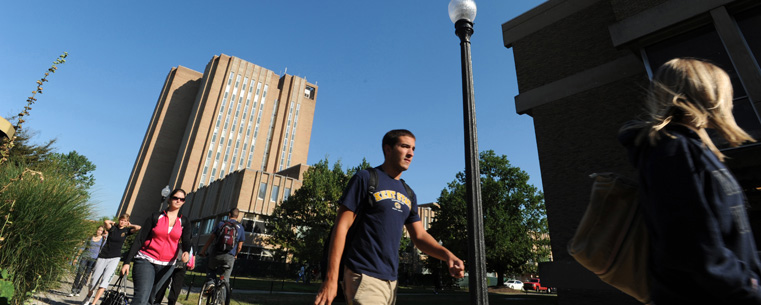 Students make their way across campus between classes. <a style=&quot;&quot; src=&quot;&quot; id=&quot;CP___PAGEID=5141,index.cfm,38&#124;&quot; href=&quot;/admissions/explore/visit/index.cfm&quot;>Register to visit</a> Kent State.